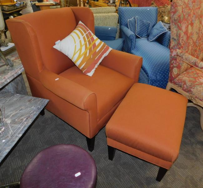Bassett orange rust wing back arm chair