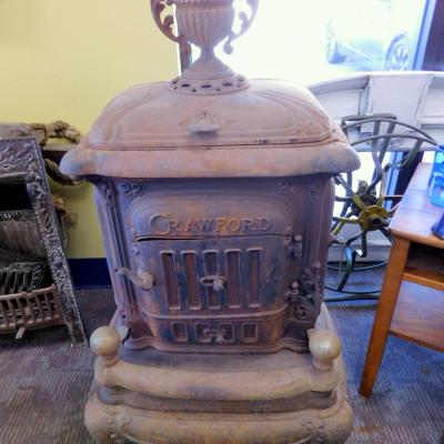 Antique Crawford 22 cast iron pot belly stove over Walker Pratt Boston MA
